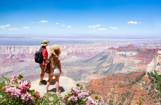 A couple in Grand Canyon National Park, Arizona, USA - one of Southall Travel's destinations. The company has paid all travel refunds due to Covid-19